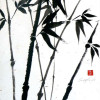 a black and white sumi painting of crossed bamboo on gold flecked paper.