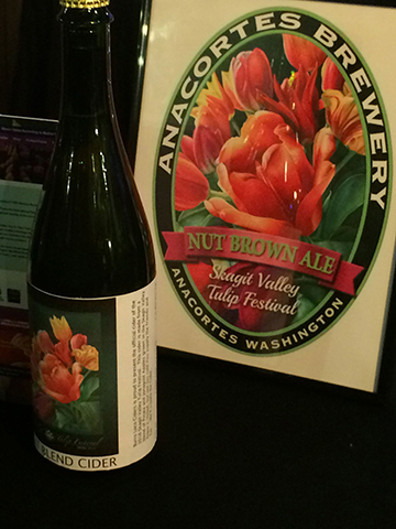 Beer label and cider bottle with poster art.
