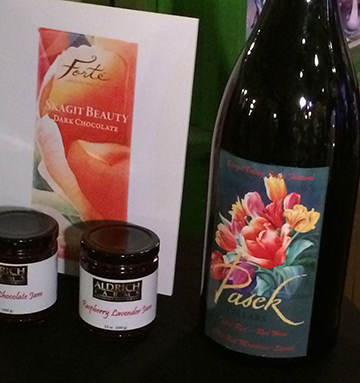 Chocolate packaging and wine bottle with poster art.